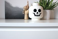 This cool lego skull is the perfect storage container for my jewellery. styled with a wooden hay hand a painting. Visit my blog for more : http://mamaisonnordique.wordpress.com