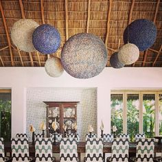 #Repost @martynbullard  This popped up today on Insta so I had to repost it ... The Francis estate dining room in Punta Mita Mexico .... With its cathedral like ceilings hung with woven wicker balls that we had custom colored in indonesia reflecting the colors in my Mamounia wave fabric that upholsters the chairs. #mexicanstyle #designanddecoration #anoldiebutagoodie #tbt