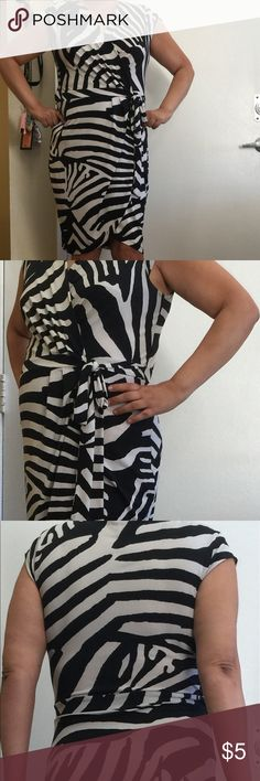 H&M Zebra Print Dress GUC summer dress in wrap tie zebra print black and white from HM. Great dress for going out, party, or work, comfortable soft material and easy to wear. The dress is an off white and does have some stitching pulling (see last pic) but not really noticeable still has life! H&M Dresses Midi