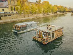Two photographers are sailing through Europe in amazing handbuilt houseboats