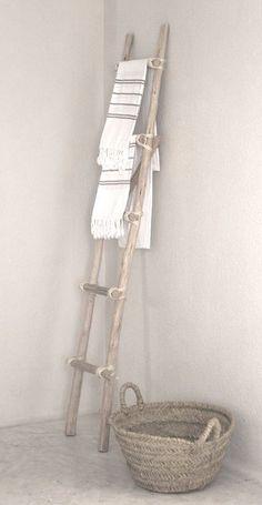 vintage ladder with woven basket