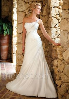 Gown features lace and detachable asymmetrical strap.