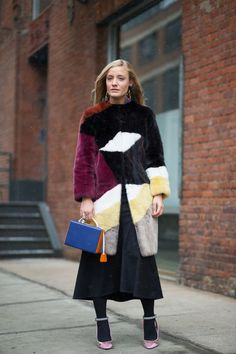 Kate Foley in Fendi, Tibi Agathe fluted skirt (available March) and Mark Cross bag