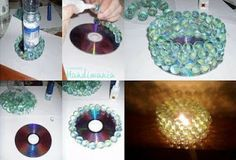 Make a candle holder using an old CD, glue, and some marbles.