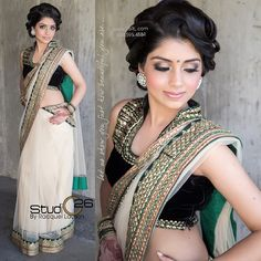 Off white saree with green and gold border. Black sleeveless collared blouse with gold work.