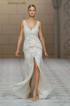 Pronovias 2015...Love this modern, mature but feminine bridal look. Cheaper to have custom-made than purchasing from salon. Adjust the neckline & pick 1-3 details that fit your style.