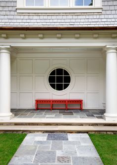 Bluestone & Limestone entryway with red Bench in a garden by Howard Design Studio.