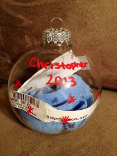 DIY: Stuff a clear, glass Christmas bulb with your baby's (and mom's) hospital bracelets along with the baby's first hat.  Makes a great keepsake!