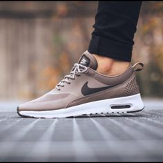 Nike Air Max Thea Iron/Dark Storm/White Brand new Nike Air Max Thea! Sold out everywhere! Brand new in box. Run half size small. Nike Shoes Sneakers