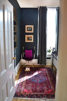Moody Blue Bedroom with Colorful Persian Rug