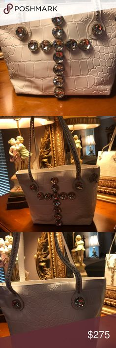 """Raviani Handbag Original Raviani Handbag.  Large Swarovski crystals are 1 1/2 """".   The straps have crystals all the way. All are incased not prong set.  No ink or scratches.  An absolute great Handbag  Used a couple times. Leather and a real eye catcher  Kept in dust bag💝 Raviani Accessories"""