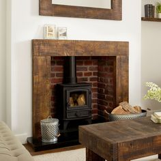 About the Grosvenor solid oak beam fire surround The Grosvenor fire surround is styled from deep sawn solid oak beams and treated with a dark tudor Fireplace Bookcase, Home Fireplace, Fireplace Surrounds, Fireplace Design, Brick Fireplace, Fireplace Ideas, Fireplace Poker, Fireplace Inserts, Rustic Fireplace Decor