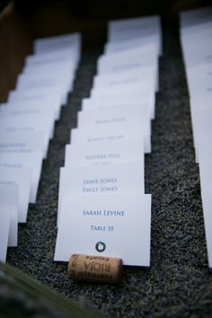 escort cards in a crate full of dried lavender