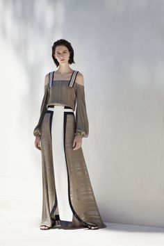 Resort 2017 | Botanica Lysia , khaki , textured silk blouse with cutout shoulders and handmade cotton trim straps . Lotus , khaki , graphic long skirt made of a blend of silk textures in contrasting colors . Xenos , black calf nappa and suede leather sandals with geometric shaped panels. #zeusndione