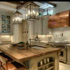 LOVE! Reclaimed wood counter top + exposed beams