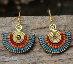 These earrings are fashioned from hand shaped brass wire. Waxed cotton is woven around the brass to give a beautiful tribal look to the earrings.