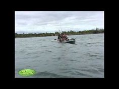 Catching a huge salmon while Kayak Fishing. Andy TheCameraMan from GetReeled.com catches an awesome salmon that takes him for a ride in his Hobie Pro Angler.