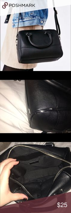 UO Cooperative Effie Duffle Bag Vegan Leather bag from Urban Outfitters with silver hardware. Comes with detachable cross body strap. A small bag, but holds a lot! Some damage shown in picture, on piping. This bag is SOLD OUT at Urban currently. Make me an offer, looking to sell ASAP! Urban Outfitters Bags Crossbody Bags