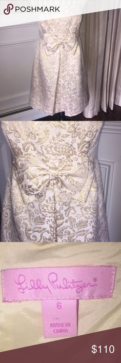 Lilly Pulitzer dress...Size 6 Exquisite dress by Lilly Pulitzer...Betsey Dress Brocade in cream and gold...strapless dress with a beautiful bow in the front...Size 6...no rips, stains or snags...from a smoke free home...dress retailed new for $348! Lilly Pulitzer Dresses Strapless