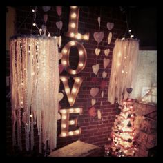 Fabric Chandeliers and marquee letters, feather tree, shabby chic, vintage Valentine's Day, store display west Des Moines Iowa Valley Junction