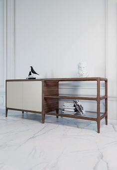 BELLAGIO SIDEBOARD  Bellagio is a new collection characterized by skillfully created decisive lines, which aspires to satisfy the most sophisticated tastes, proposing refined objects preciously finished in every detail. Mixing refined rigorously natural materials, to a finely carved solid wooden structure, Bellagio offers a complete furnishing from the living area to the bedroom area.