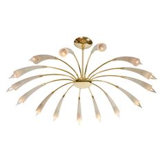 Eighteen-arm brass chandelier with tapered and smoked glass shades.
