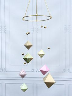 A personal favorite from my Etsy shop https://www.etsy.com/listing/385041590/modern-baby-mobile-pink-gold-mint-baby