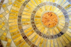 A mosaic sun that would look neat on tiled floor, this site has info on getting started making mosaics.