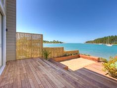 Book this holiday apartment in Mapua, Oceania. View photos, facilities and availability. Holiday apartment rental: 2 Bedrooms, Sleeps 4 in Mapua Rabbit Island, Australia Hotels, Holiday Accommodation, Rental Property, Pacific Ocean, Dining Area, Kayaking, Places To Go, Deck