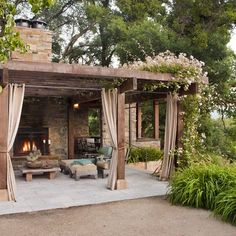 I love a pergola with outdoor curtains!