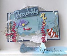 Handmade card by DT member Marleen with Collectables Eline's Tropical Fish (COL1431), Craftables Banners (CR1299), Nautical Rope (CR1405), Coral (CR1406), Card Stand (CR1408) and Creatables Ropes (LR0418) from Marianne Design