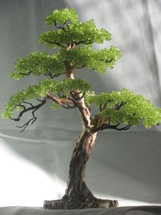 Bonsai is generally a tree or plant that has actually been kept smaller sized than its typical size. The technique to making a bonsai plant is to frequently prune the tree every spring Bonsai Trees For Sale, Bonsai Tree Types, French Beaded Flowers, Victorian Flowers, Beaded Crafts, Wire Crafts, Ikebana, Bonsai Wire, Tree Of Life Art