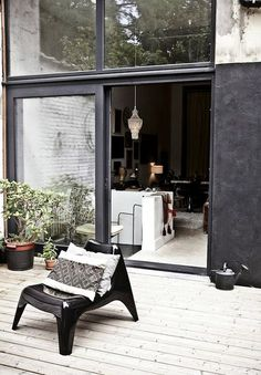 glass wall with moroccan pendant light and black patio furniture via milk decoration. / sfgirlbybay