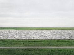"""If you're familiar with Andreas Gursky, his photograph """"Rhein II"""" is shot in the style of deadpan photography. It just so happens that it's one of the most expensive photographs in the world. Andreas Gursky, Cindy Sherman, Max Ernst, Contemporary Photography, Landscape Photography, Minimal Photography, Conceptual Photography, Architectural Photography, Photography Gallery"""