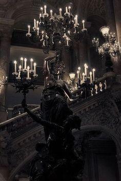 Gothic candelabra; dark, moody atmosphere.