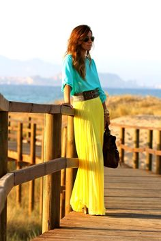 Shirt- Blue button up blouse  Skirt- Bright Yellow Maxi  Belt- Large Black or White Belt  Watch- Black or White  Shoes- Gladiator Sandals