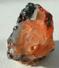 Fire Opal from Mexico. It is a karmic stone- it encourages putting out positive emotions and teaches that what you put out comes back to you. The opal is also a representative of justice and harmony, and is a protective stone. Cool Rocks, Beautiful Rocks, Minerals And Gemstones, Rocks And Minerals, Rock Collection, Mineral Stone, Rocks And Gems, Stones And Crystals, Gem Stones