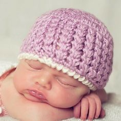 This free crochet hat pattern features an elegant crochet stitch called the Trinity Stitch. It's fun and cute, and resembles tiny flowers!