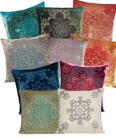 Morroccan Velvet pilllows...love the feel, texture, and design, and very high quality, compared to man other velvet pillows. This type in my bedroom, and a few like these that blend colors with my orange couch