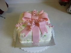 Birthday gift cake with bow.