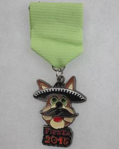 The Spurs Coyote is out front on the 2015 Silver & Black Give Back Fiesta Medal. The $10 medal has been sold at  San Antonio Spurs' home games since March 20. All proceeds will go to the nonprofit organization's youth programs such as Team Up Challenge and the Spurs Youth Basketball League.Award: First place, sports Photo: By Juanito Garza,  San Antonio Express-News / San Antonio Express-News