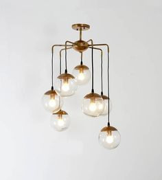Mid Century Modern Handcrafted Bubble Glass Balls & Brass Chandelier Ceiling Light diam 27 We are very proud to present the newest addition to our range - this gorgeous 70s inspired handcrafted ceiling light fixture. All our items are carefully handcrafted from pure brass components in our workshop. Processing of our raw materials is gentle, so the original feel of the material and its character remain intact – with a focus on good design, high quality and our aim to exceed your expecta...