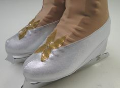 New Cinderella Glass Slipper Skate Boot Cover 2015 / Figure Skating / Ice Skating / Roller Skating These silver high heel skate boot covers are perfect if you're skating as Cinderella with her Glass Slippers. Created with a gold butterfly adorning the glass slipper, these skate boot covers are inspired from the movie Cinderella 2015. The boot covers are made of silver metallic fabric, and the butterfly is gold lycra adorned with Swarovski rhinestones.