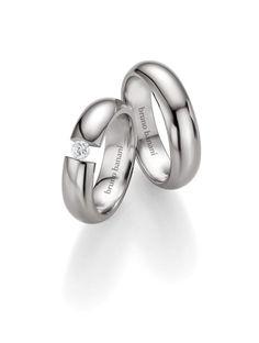 Βέρες Γάμου BRUNO BANANI από Τιτάνιο με Ζιργκόν Αναφορά 014408 Ζευγάρι βέρες γάμου από τιτάνιο σε λευκό χρώμα. Η γυναικεία βέρα είναι διακοσμημένη με ημιπολύτιμη πέτρα. Το φάρδος της κάθε βέρας είναι 6 χιλιοστά. Η τιμή αφορά το ζευγάρι βέρες. Bruno Banani, Wedding Rings, Wedding Ideas, Engagement Rings, Jewelry, Enagement Rings, Jewlery, Jewerly, Schmuck