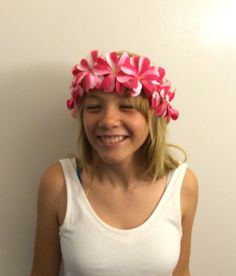 A personal favorite from my Etsy shop https://www.etsy.com/listing/238395711/pink-hula-tropical-plumeria-flower-crown