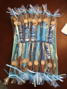 Dipped pretzel sticks for a thank you gift for baby shower guests. The kids ate these like cray!