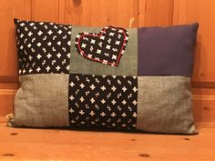 A personal favourite from my Etsy shop https://www.etsy.com/uk/listing/466239652/blue-patchwork-cushion-up-cycled-denim
