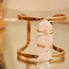 Raw Quartz Cuff Bracelet This bracelet is a gold setting with a 2 inch Quartz stone spanning the length of the bracelet. Farah Jewelry Jewelry Bracelets