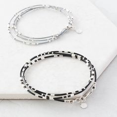 Morse Code Message Wrap Bracelet.  Using Morse code, a combination of tiny silver dots and dashes will spell out your message. On soft leather that wrap around the wrist, a perfect way to wear a personalised gift.   Made from soft leather and sterling silver
