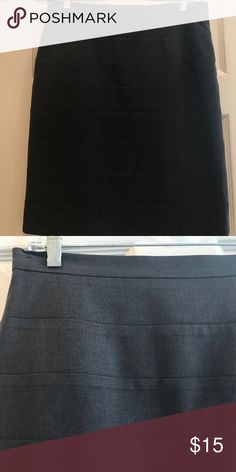 Charcoal gray skirt Lightweight wool pencil skirt. All-season weight. Sewn-down horizontal pleat detail. Fully lined Vanity Skirts Pencil